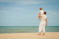 Father and son playing at the beach. Father and son standing at the beach at the day time Royalty Free Stock Images