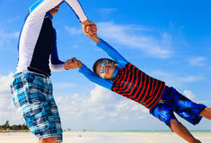 Father and son playing on the beach Royalty Free Stock Photos