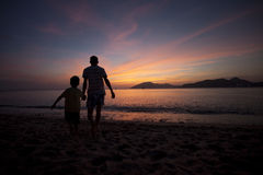Father and son playing on beach Royalty Free Stock Photography