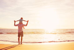 Father and Son Playing on the Beach at Sunset Royalty Free Stock Photography