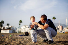 Father and son playing on the beach Royalty Free Stock Photo