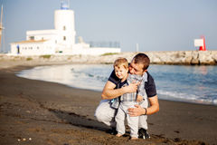 Father and son playing on the beach Royalty Free Stock Image