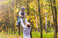 Father and son playing in a beautiful autumn park Stock Images