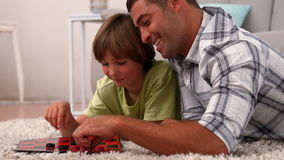 Father and son playing board game stock video footage
