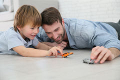 Father and son playing with car toys Royalty Free Stock Image