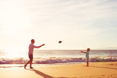 Father and Son Playing Catch Throwing Football Royalty Free Stock Photography