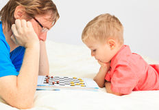 Father and son playing checkers Stock Image