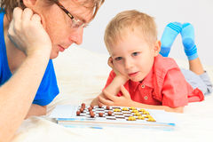 Father and son playing checkers Royalty Free Stock Photography