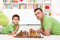 Father and son playing chess. Family spending time together royalty free stock photography