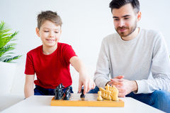 Father and son playing chess. Father and son are playing chess together royalty free stock photos