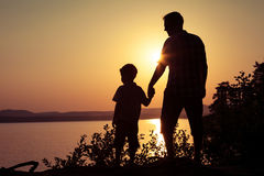 Father and son playing on the coast of lake Stock Photography
