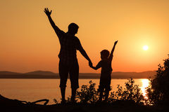 Father and son playing on the coast of lake Royalty Free Stock Image