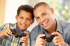 Father and son playing computer games Stock Photos