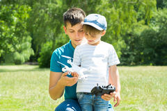 Father And Son Playing With The Drone Royalty Free Stock Photos