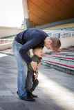 Father and son playing in empty stadium. Father tickles his son in empty stadium Royalty Free Stock Photo