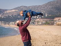 Father and son playing and enjoying the beach royalty free stock photos