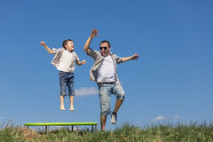 Father and son playing on the field at the day time. Stock Photo