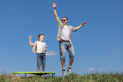 Father and son playing on the field at the day time. Royalty Free Stock Photography