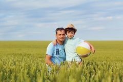 Father and son are playing in the field. Father`s Day royalty free stock images