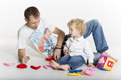 Father and son playing on the floor Royalty Free Stock Images