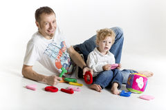 Father and son playing on the floor isolated on white Royalty Free Stock Photo