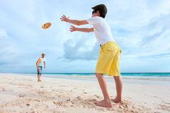 Father and son playing with flying disk Royalty Free Stock Images