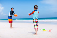 Father and son playing with flying disk Royalty Free Stock Image