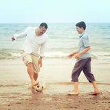 Father and son  playing with a footba Royalty Free Stock Photos