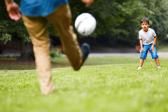 Father and son playing football in the park Royalty Free Stock Images