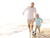 Father and son playing football together Royalty Free Stock Images