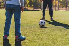 Father and son playing football together Stock Images
