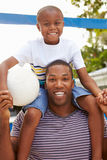 Father And Son Playing Game Of Volleyball In Garden Stock Photography