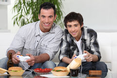 Father and son playing games Stock Images