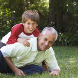 Father and son playing in a garden Royalty Free Stock Photography