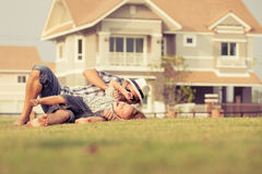Father and son playing on the grass Royalty Free Stock Image