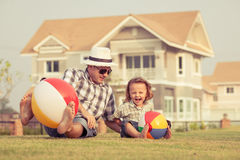 Father and son playing on the grass Royalty Free Stock Photography