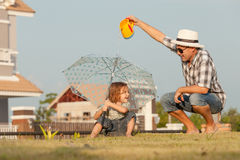 Father and son playing on the grass Royalty Free Stock Photos