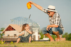 Father and son playing on the grass Royalty Free Stock Images