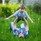 Father and son playing in the grass. Family. Stock Image