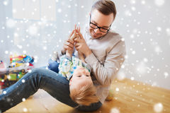Father with son playing and having fun at home. Childhood, fatherhood, leisure and people concept - happy father and little son playing and having fun at home Stock Photos