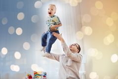 Father with son playing and having fun at home Stock Photography