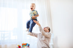Father with son playing and having fun at home Royalty Free Stock Photos