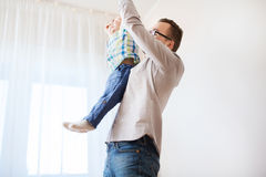 Father with son playing and having fun at home Stock Image