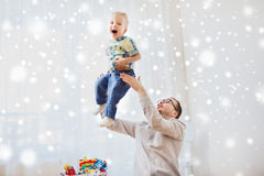 Father with son playing and having fun at home. Family, childhood, fatherhood, leisure and people concept - happy father and little son playing and having fun at Stock Image