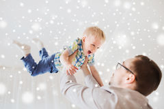 Father with son playing and having fun at home. Family, childhood, fatherhood, leisure and people concept - happy father and little son playing and having fun at Royalty Free Stock Photos