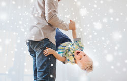 Father with son playing and having fun at home. Family, childhood, fatherhood, leisure and people concept - happy father and little son playing and having fun at Royalty Free Stock Photography