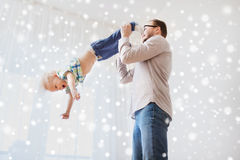 Father with son playing and having fun at home. Family, childhood, fatherhood, leisure and people concept - happy father and little son playing and having fun at Royalty Free Stock Image
