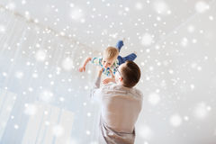 Father with son playing and having fun at home. Family, childhood, fatherhood, leisure and people concept - happy father and little son playing and having fun at Stock Images
