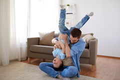 Father with son playing and having fun at home. Family, childhood, fatherhood, leisure and people concept - happy father and little son playing and having fun on Stock Photos