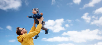 Father with son playing and having fun outdoors Royalty Free Stock Images